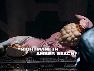 "Title Card for ""Nightmare in Amber Beach""."
