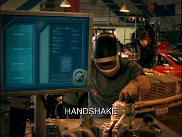"Title Card for ""Handshake""."
