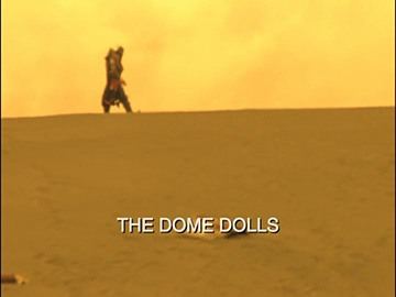 "Title Card for ""The Dome Dolls""."