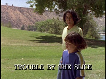 "Title Card for ""Trouble by the Slice""."