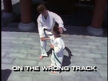 "Title Card for ""On the Wrong Track""."