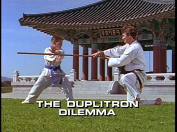 "Title Card for ""The Duplitron Dilemma""."