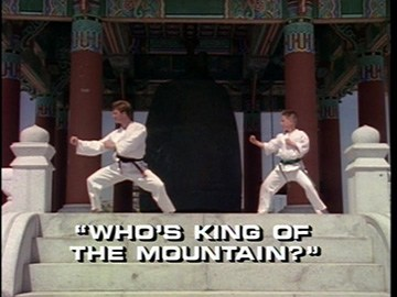 "Title Card for ""Who's King of the Mountain?""."